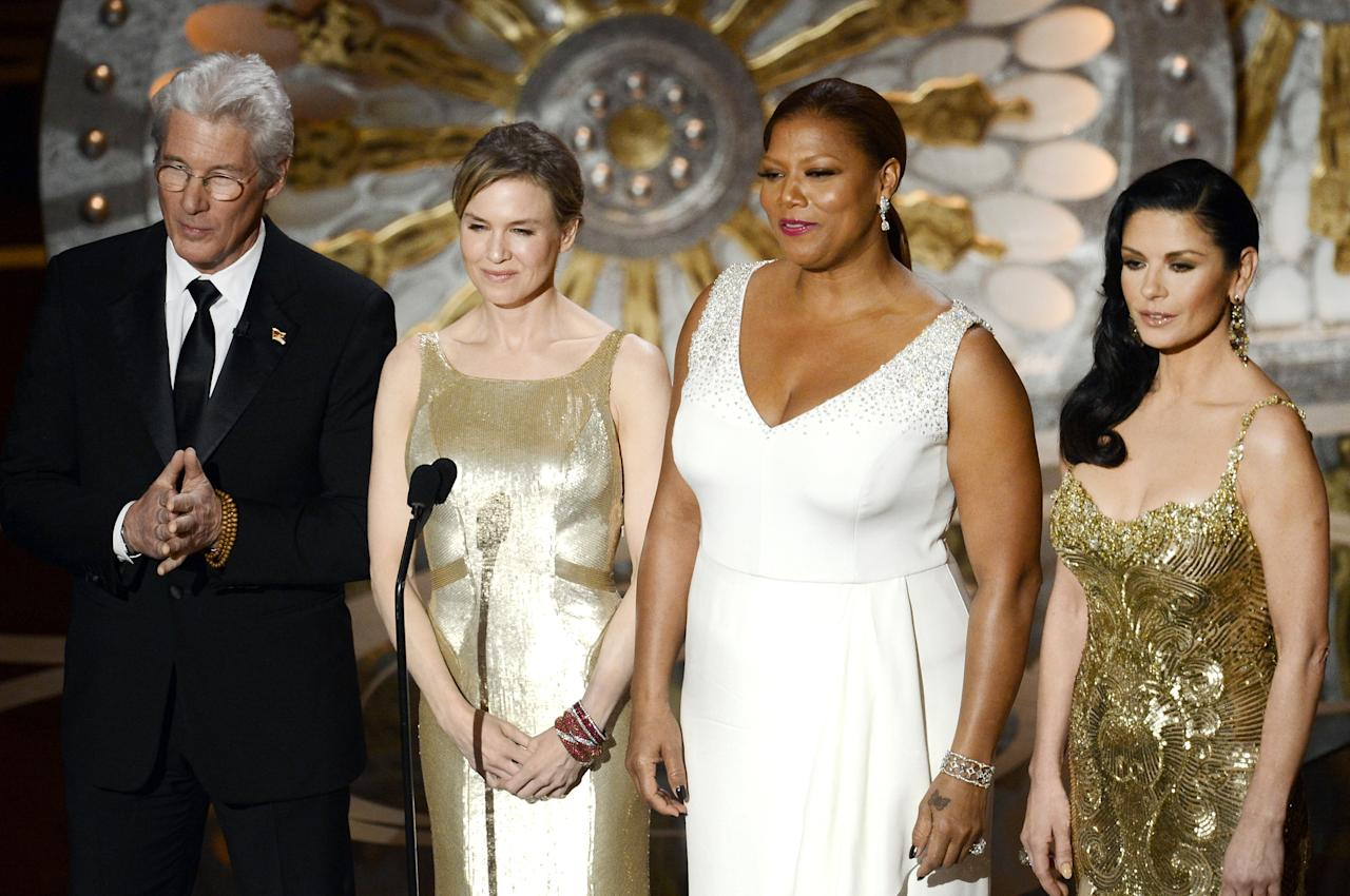 HOLLYWOOD, CA - FEBRUARY 24:  Actor Richard Gere, actresses Renee Zellweger, Queen Latifah and Catherine Zeta-Jones present onstage during the Oscars held at the Dolby Theatre on February 24, 2013 in Hollywood, California.  (Photo by Kevin Winter/Getty Images)