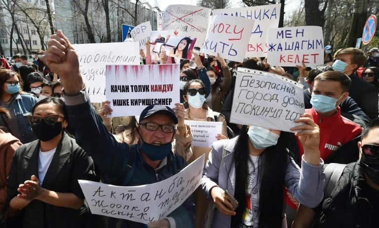 """Protesters held banners bearing slogans such as """"Who will answer for Aizada's murder?"""", """"End the femicide"""" and """"Who still thinks that murder is a tradition?"""""""