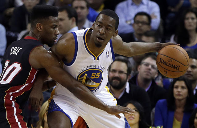 Miami Heat's Norris Cole, left, guards Golden State Warriors' Jordan Crawford (55) during the first half of an NBA basketball game on Wednesday, Feb. 12, 2014, in Oakland, Calif. (AP Photo/Ben Margot)