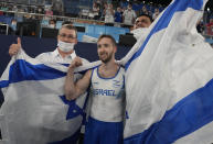 Artem Dolgopyat of Israel, celebrates after winning the gold medal on the floor exercise during the artistic gymnastics men's apparatus final at the 2020 Summer Olympics, Sunday, Aug. 1, 2021, in Tokyo. (AP Photo/Natacha Pisarenko)