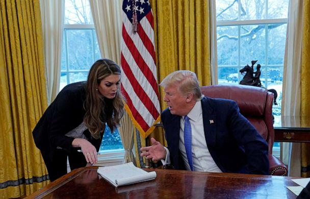 PHOTO: President Donald Trump confers with White House Communications Director Hope Hicks during an interview with Reuters at the White House in Washington, Jan. 17, 2018. (Kevin Lamarque/Reuters, FILE)