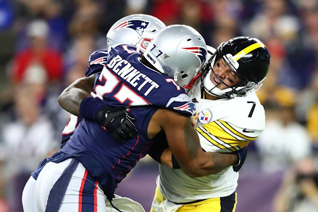 Ben Roethlisberger was swarmed by the Patriots defense, including Michael Bennett (77). (Getty Images)