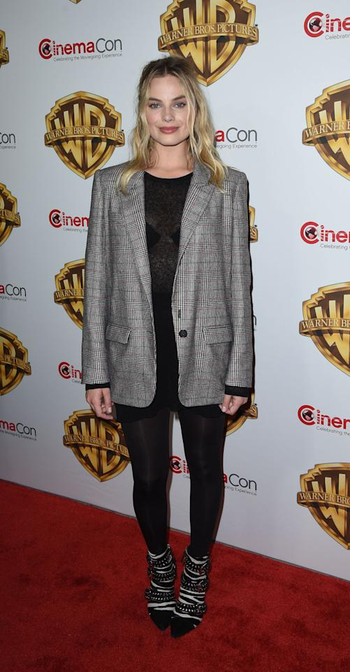 <p>Margot Robbie's borrowed-from-the-boys blazer look gets an edgy, new-season update from some studded statement booties. </p>