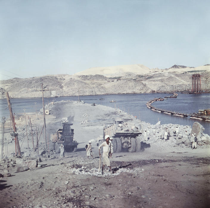 FILE - In this April 1964 file photo, a truck enters a tunnel during construction of the Aswan High Dam over the river Nile in Egypt. Egyptians are marking 50 years since the inauguration of the Nile dam, a massive feat of construction that has shaped the course of modern-day Egypt. It spared it from seasonal droughts and flooding, and generated electricity. (AP Photo, File)