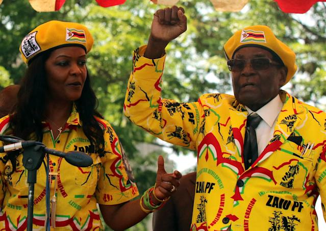 President Robert Mugabe and his wife, Grace Mugabe, attend a rally of his ruling ZANU-PF party in Harare on Nov. 8. (Philimon Bulawayo / Reuters)