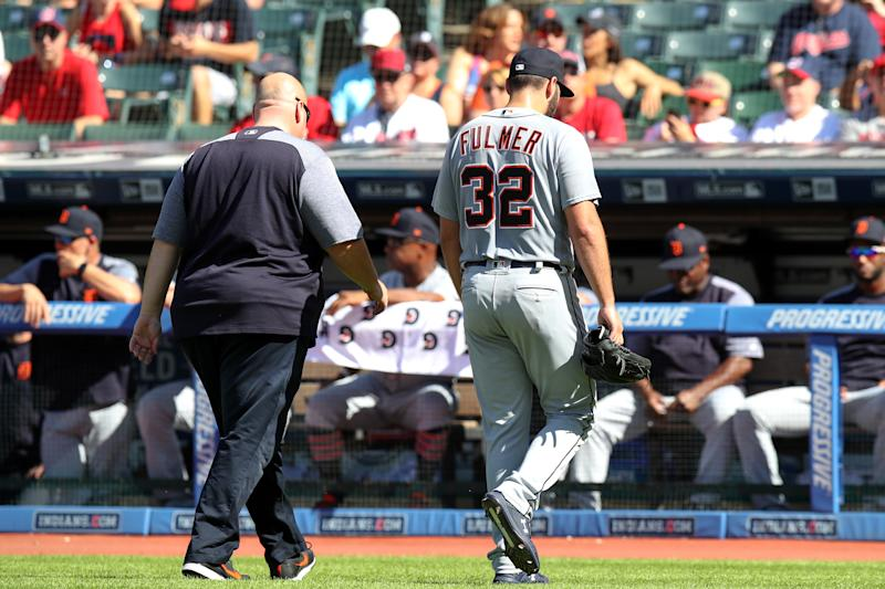 CLEVELAND, OH - SEPTEMBER 15: Detroit Tigers starting pitcher Michael Fulmer (32) leaves the field with a trainer as he was forced to leave the game after giving up back to back home runs to start the Cleveland half of the first inning of the Major League Baseball game between the Detroit Tigers and Cleveland Indians on September 15, 2018, at Progressive Field in Cleveland, OH. (Photo by Frank Jansky/Icon Sportswire via Getty Images)