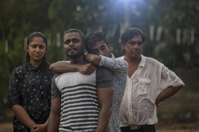Mourners grieve at the burial of three members of the same family victims of Easter Sunday bomb blast at St. Sebastian Church in Negombo, Sri Lanka, Monday, April 22, 2019. Easter Sunday bombings of churches, luxury hotels and other sites was Sri Lanka's deadliest violence since a devastating civil war in the South Asian island nation ended a decade ago. (AP Photo/Gemunu Amarasinghe)
