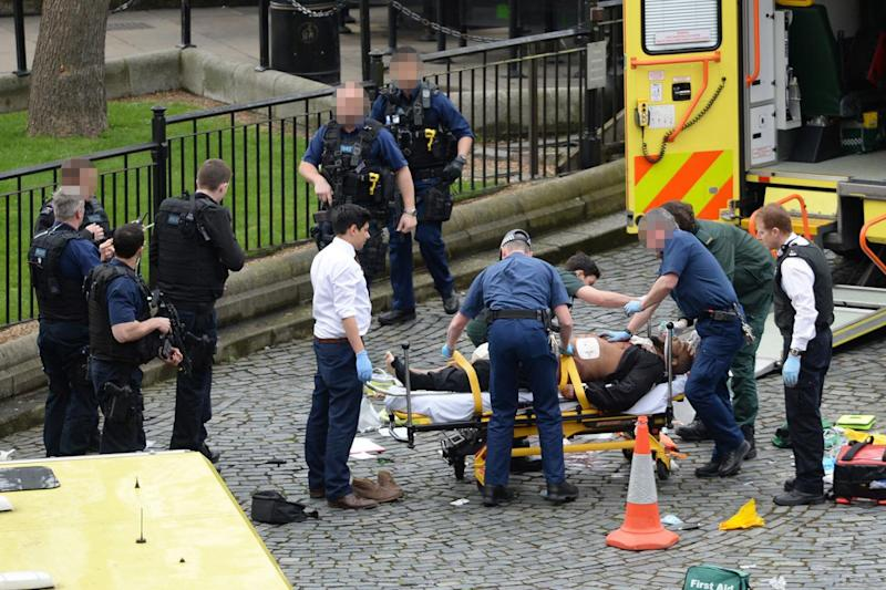 Killer Khalid Masood being treated after he mowed down pedestrians and killed PC Keith Palmer (Stefan Rousseau/PA )
