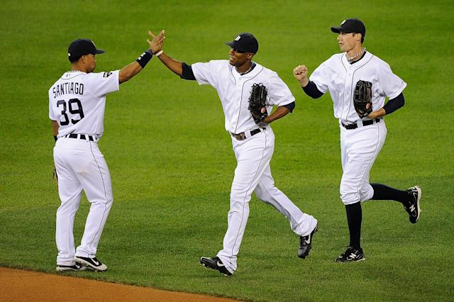 DETROIT, MI - OCTOBER 13: Ramon Santiago #39, Austin Jackson #14, and Don Kelly #32 of the Detroit Tigers celebrate after defeating the Texas Rangers 7-5 in Game Five of the American League Championship Series at Comerica Park on October 13, 2011 in Detroit, Michigan. (Photo by Kevork Djansezian/Getty Images)