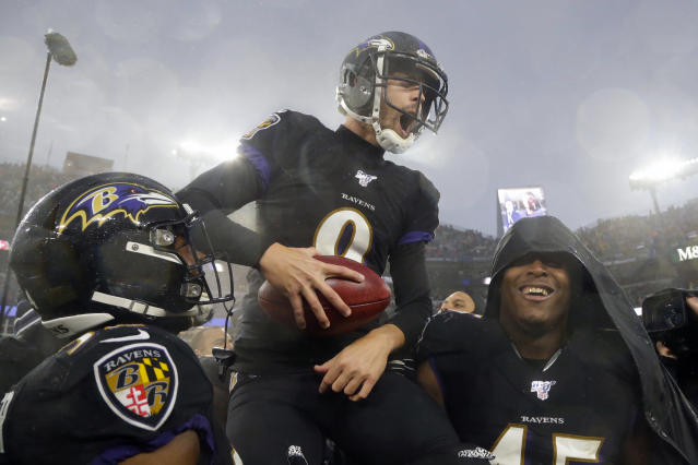 Baltimore Ravens kicker Justin Tucker (9) offered a helping hand before the third day of the draft. (AP Photo/Julio Cortez, File)