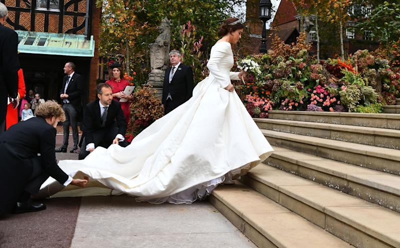 Eugenie making her way up the steps to the chapel.