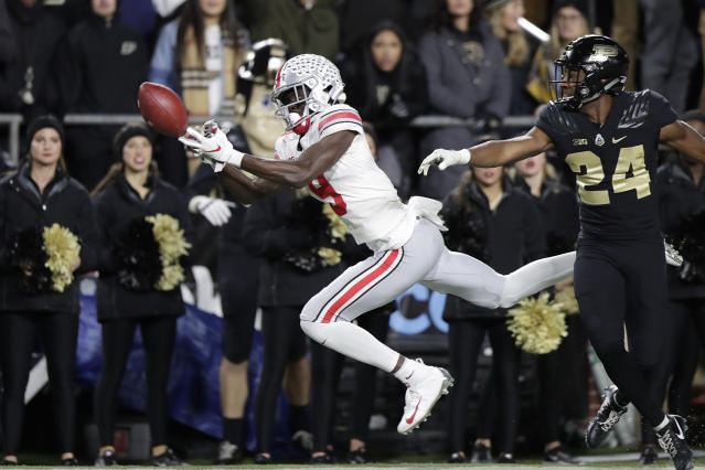 Ohio State wide receiver Binjimen Victor (9) drop a catch in front of Purdue cornerback Tim Cason (24) during the second half of an NCAA college football game in West Lafayette, Ind., Saturday, Oct. 20, 2018. (AP Photo/Michael Conroy)