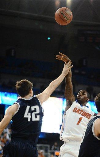 Florida's Kenny Boynton (1) releases a 3-pointer over Yale's Matt Townsend (42) during the first half of an NCAA college basketball game in Gainesville, Fla., Saturday, Dec. 31, 2011. Florida defeated Yale 90-70. (AP Photo/Phil Sandlin)