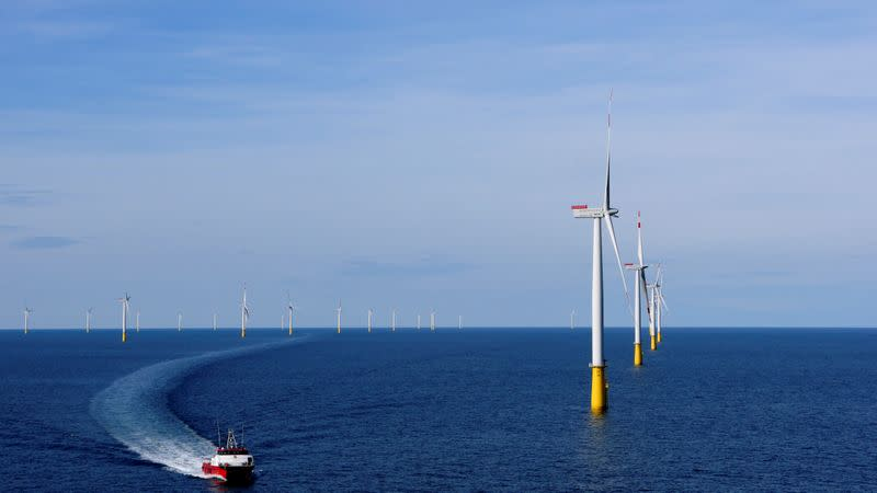FILE PHOTO: A boat sails past DanTysk wind farm, 90 kilometres west of Esbjerg