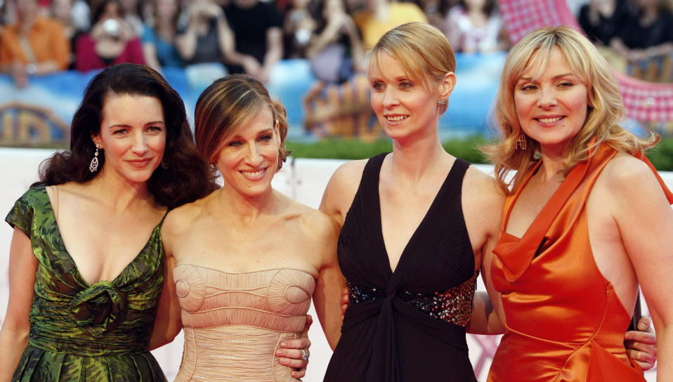 Actresses (L-R) Kristin Davis, Sarah Jessica Parker, Cynthia Nixon and Kim Cattrall arrive for the German premiere of ''Sex And The City: The Movie'' at a cinema in Berlin May 15, 2008.    REUTERS/Fabrizio Bensch (GERMANY)
