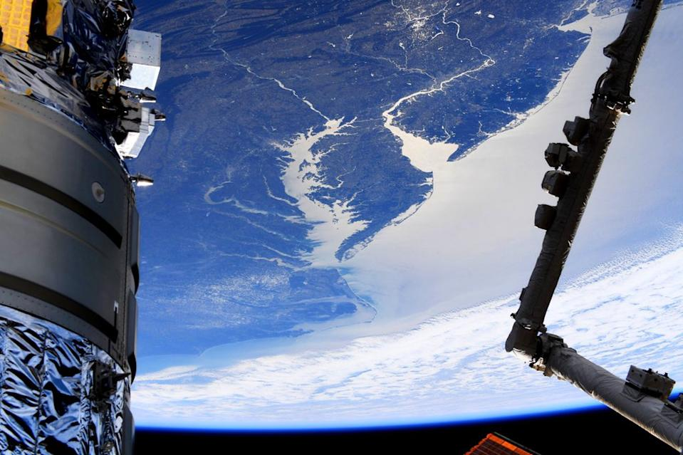 A new view of Earth from the International Space Station features much of the Eastern Seaboard of the U.S., stretching from New York City to South Carolina. NASA astronaut Andrew Morgan shared the photo on Twitter last Thursday (March 12). In the foreground on the left side of the frame is Northrop Grumman's Cygnus NG-13 cargo resupply spacecraft, which arrived at the space station Feb. 18. On the right is a portion of the station's Canadarm2 robotic arm.