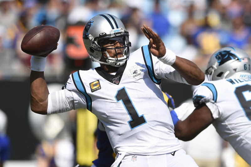 FILE - In this Sept. 9, 2019, file photo, Carolina Panthers quarterback Cam Newton looks for a receiver during the team's NFL football game against the Los Angeles Rams during the second half in Charlotte, N.C. The New England Patriots have reached an agreement with free-agent quarterback Newton, bringing in the 2015 NFL Most Valuable Player to help the team move on from three-time MVP Tom Brady, a person with knowledge of the deal told The Associated Press. (AP Photo/Mike McCarn, File)