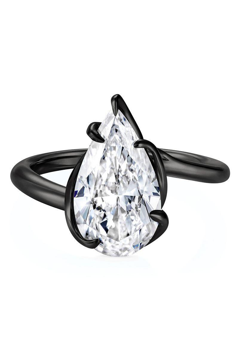 "<p><em><strong>Thelma West </strong>""Rebel Black"" Ring with pear shaped diamond in 18K black gold, price upon request, <a href=""http://www.thelmawest.com/"" rel=""nofollow noopener"" target=""_blank"" data-ylk=""slk:thelmawest.com"" class=""link rapid-noclick-resp"">thelmawest.com</a>.<br></em><br><a class=""link rapid-noclick-resp"" href=""http://www.thelmawest.com/"" rel=""nofollow noopener"" target=""_blank"" data-ylk=""slk:SHOP"">SHOP</a></p>"