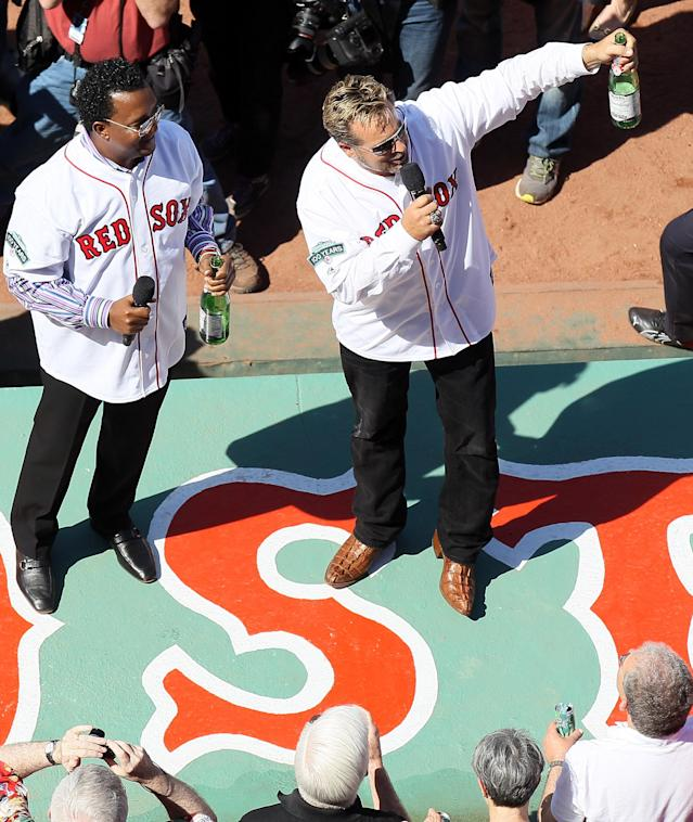 BOSTON, MA - APRIL 20: Former Boston Red Sox players Pedro Martinez and Kevin Millar lead a toast before the game between the New York Yankees and the Boston Red Sox on April 20, 2012 at Fenway Park in Boston, Massachusetts. Today marks the 100 year anniversary of the ball park's opening. (Photo by Elsa/Getty Images)