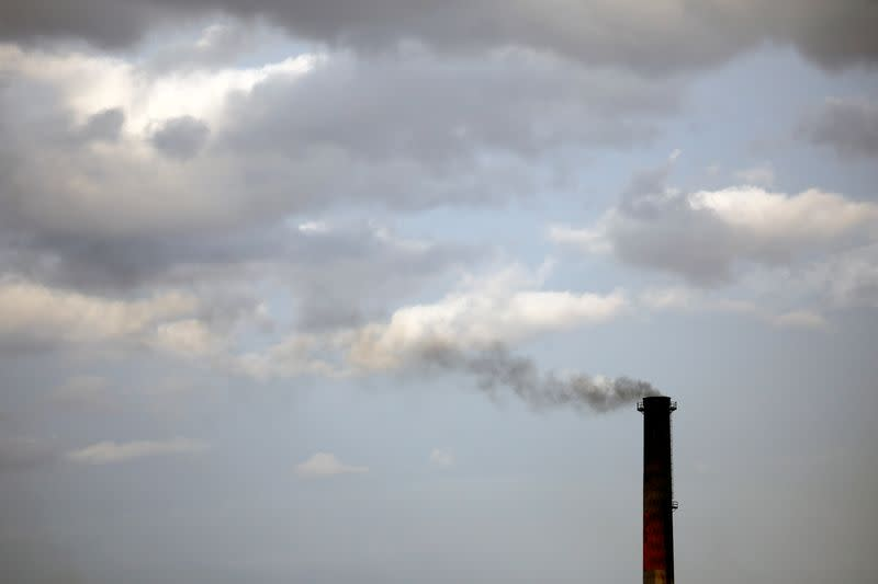 Smoke rises from a coke factory in the village of Lukavac near Tuzla