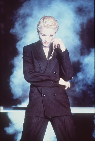 "<div class=""caption-credit""> Photo by: AP</div><div class=""caption-title""></div><b>Madonna in 1990</b> <br> After the hyper-feminine cone bras and corsets we loved when Madonna began incorporating menswear into her costumes."