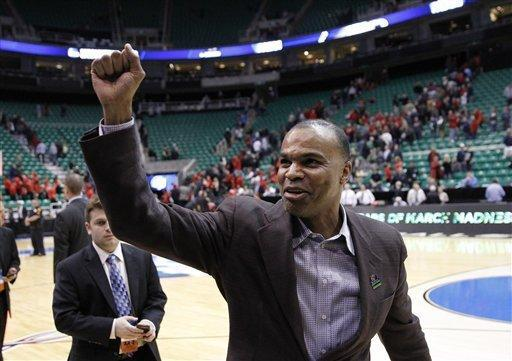 Harvard head coachTommy Amaker celebrates after his team defeated New Mexico New Mexico 68-62 during a second-round game in the NCAA college basketball tournament in Salt Lake City Thursday, March 21, 2013. (AP Photo/Rick Bowmer)