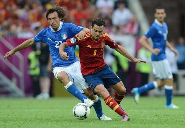 Spanish midfielder Xavi Hernandez (R) vies with Italian midfielder Andrea Pirlo during the Euro 2012 championships football match Spain vs Italy on June 10, 2012 at the Gdansk Arena. AFP PHOTO / CHRISTOF STACHECHRISTOF STACHE/AFP/GettyImages