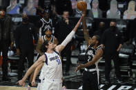Dallas Mavericks center Boban Marjanovic (51) defends against Los Angeles Clippers forward Kawhi Leonard (2) during the second quarter of Game 7 of an NBA basketball first-round playoff series Sunday, June 6, 2021, in Los Angeles, Calif. (AP Photo/Ashley Landis)