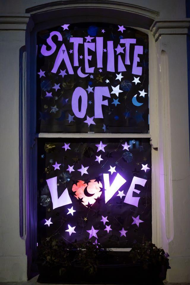 A window reading 'Satellite of Love'