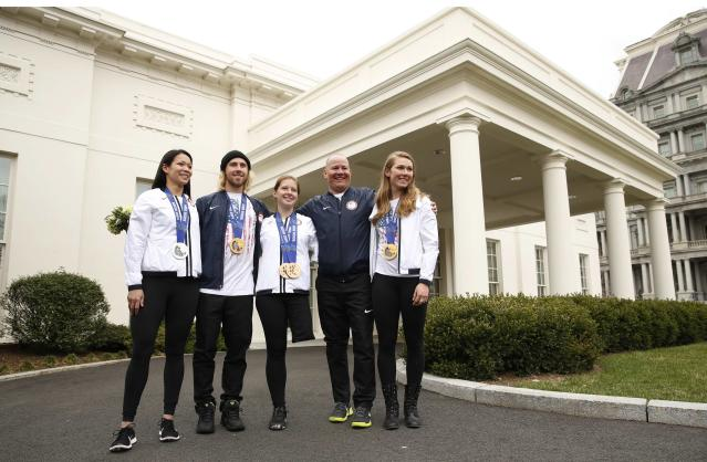 Olympians and Paralympians pose at the White House in Washington April 3, 2014. Seen (L-R) Julie Chu, Sage Kotsenburg, Stephanie Jallen, Jon Lujan and Mikaela Shiffrin. U.S. President Barack Obama and first lady Michelle Obama will honor members of the U.S. teams and delegations from the Sochi Olympics and Paralympics at the White House today. REUTERS/Kevin Lamarque (UNITED STATES - Tags: POLITICS SPORT OLYMPICS)