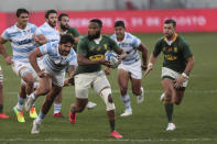 Lukhanyo Am of South Africa breaks through Argentina's defence during the second Rugby Championship match between Argentina and South Africa at the Nelson Mandela Bay Stadium, Gqebeha, South Africa, Saturday, Aug. 21, 2021. (AP Photo/Halden Krog)