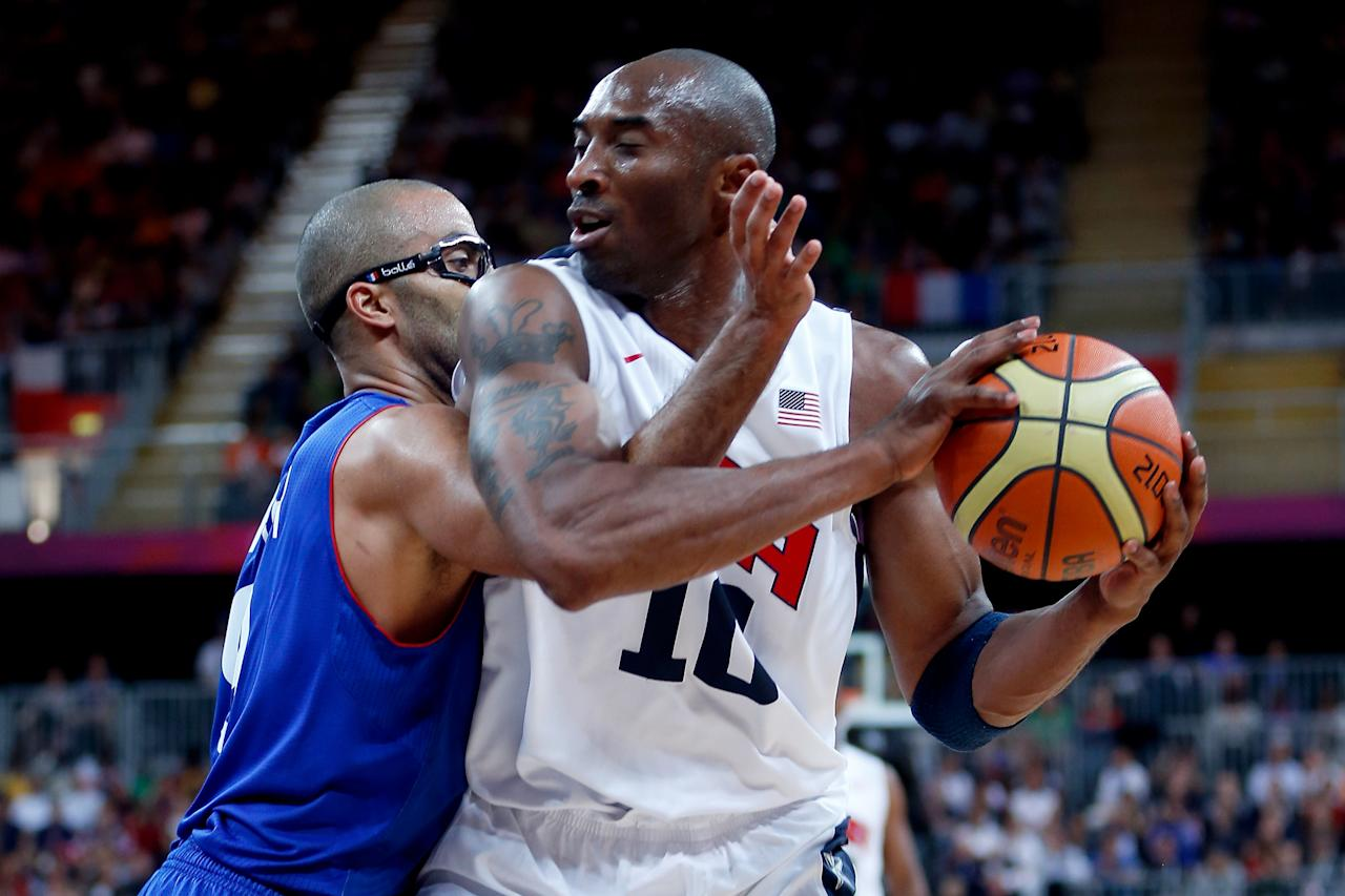 LONDON, ENGLAND - JULY 29:  Kobe Bryant #10 of United States moves the ball against Tony Parker #9 of France in the Men's Basketball Game on Day 2 of the London 2012 Olympic Games at the Basketball Arena on July 29, 2012 in London, England.  (Photo by Jamie Squire/Getty Images)