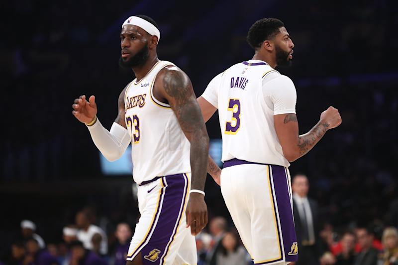 LOS ANGELES, CALIFORNIA - OCTOBER 16: LeBron James #23 and Anthony Davis #3 of the Los Angeles Lakers look on during the second half of a game against the Golden State Warriors at Staples Center on October 16, 2019 in Los Angeles, California. (Photo by Sean M. Haffey/Getty Images)
