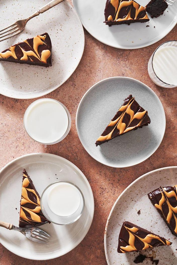 """<p>We gave the classic <a href=""""https://www.delish.com/cooking/recipe-ideas/a19473626/best-flourless-chocolate-cake-recipe/"""" rel=""""nofollow noopener"""" target=""""_blank"""" data-ylk=""""slk:flourless chocolate cake"""" class=""""link rapid-noclick-resp"""">flourless chocolate cake</a> an upgrade in the form of LOTS of peanut butter, and we think it's the cake you Reese's lovers have been dreaming of.</p><p>Get the recipe from <a href=""""https://www.delish.com/cooking/recipe-ideas/a36339267/flourless-peanut-butter-chocolate-cake-recipe/"""" rel=""""nofollow noopener"""" target=""""_blank"""" data-ylk=""""slk:Delish"""" class=""""link rapid-noclick-resp"""">Delish</a>.</p>"""