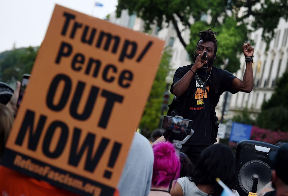 Demonstrators rally to protest US President Donald Trump's acceptance of the Republican National Convention nomination at Black Lives Matter plaza accross from the White House on August 27, 2020 in Washington, DC. (Olivier Douliery/AFP via Getty Images)