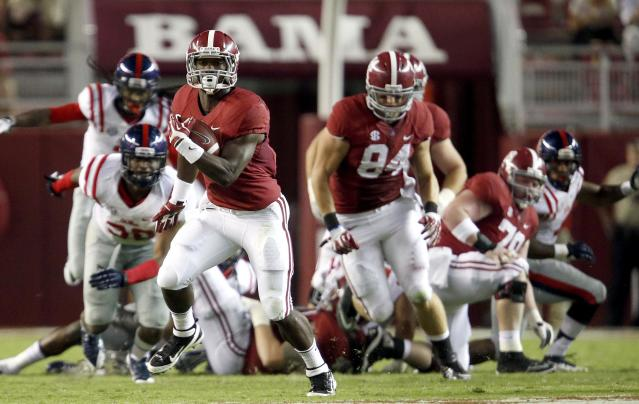 Alabama running back T.J. Yeldon (4) breaks for a 68-yard touchdown in the third quarter against Mississippi in an NCAA college football game in Tuscaloosa, Ala., Saturday, Sept. 28, 2013. (AP Photo/Tuscaloosa News, Dusty Compton)