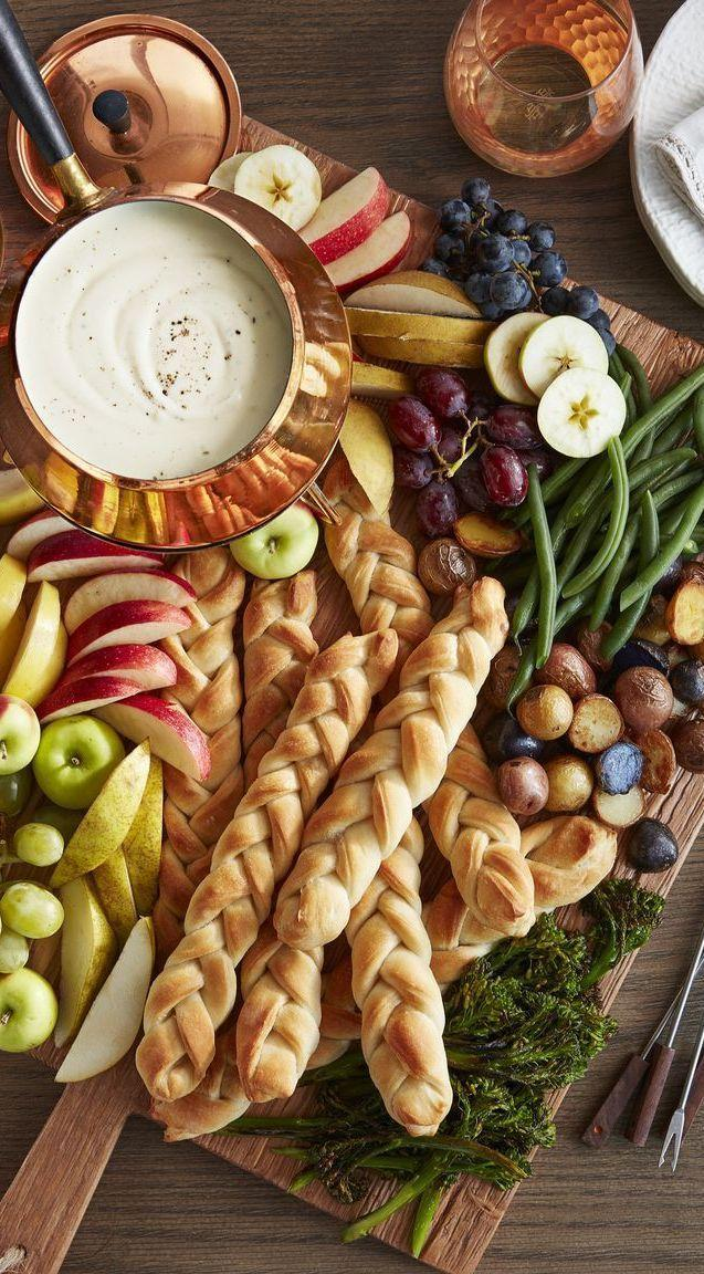 "<p>Cream cheese, Gruyère, and Emmenthaler cheeses make a decadent trio, but you can use your favorite combo of cheeses instead.</p><p><em><a href=""https://www.countryliving.com/food-drinks/a28068814/three-cheese-fondue-recipe/"" rel=""nofollow noopener"" target=""_blank"" data-ylk=""slk:Get the recipe from Country Living »"" class=""link rapid-noclick-resp"">Get the recipe from Country Living »</a></em></p>"