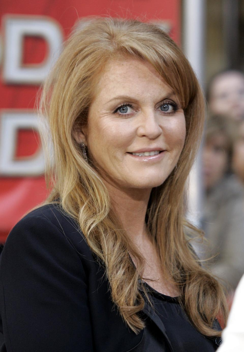 """FILE - In this Tuesday May 1, 2007 file photo, Sarah Ferguson, Britain's Duchess of York, appears on the NBC """"Today"""" television show in New York, during a segment about the Hearts & Hooves, a non-profit organization dedicated to providing healing and inspiration through meaningful encounters between humans and animals. Britain's royal family and television have a complicated relationship. The medium has helped define the modern monarchy: The 1953 coronation of Queen Elizabeth II was Britain's first mass TV spectacle. Since then, rare interviews have given a glimpse behind palace curtains at the all-too-human family within. (AP Photo/Richard Drew, File)"""