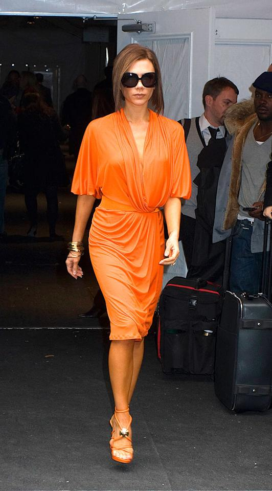 """Victoria Beckham is looking quite """"posh"""" in this salmon ensemble that accentuates her tiny, tanned frame. Janet Mayer/<a href=""""http://www.splashnewsonline.com"""" target=""""new"""">Splash News</a> - February 8, 2008"""