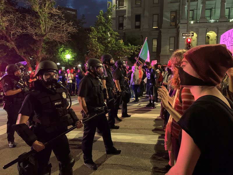 FILE PHOTO: Demonstrators face off with police near Capitol building in Denver, Colorado