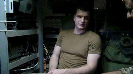 An undated picture released by Iran's Revolutionary Guards website shows an American sailor sitting in the U.S. boat detained by Iran in an unknown place, Iran. REUTERS/sepahnews.ir/TIMA/Handout via Reuters