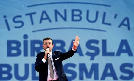 FILE PHOTO: Mayor of Istanbul Ekrem Imamoglu of the main opposition Republican People's Party (CHP) addresses his supporters during a rally in Istanbul, Turkey, April 21, 2019. REUTERS/Murad Sezer/File Photo