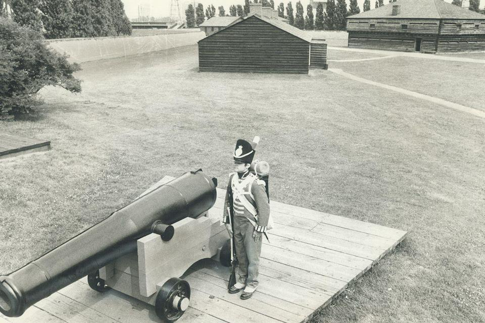 <p>A high school student dressed in an old military uniform guards a fort as part of his job in the summer of 1976.</p>