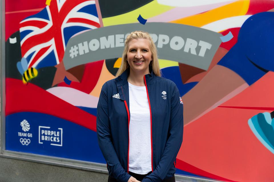 Rebecca Adlington poses in front of the mural in Manchester as part of the PurpleBricks Home Support campaign