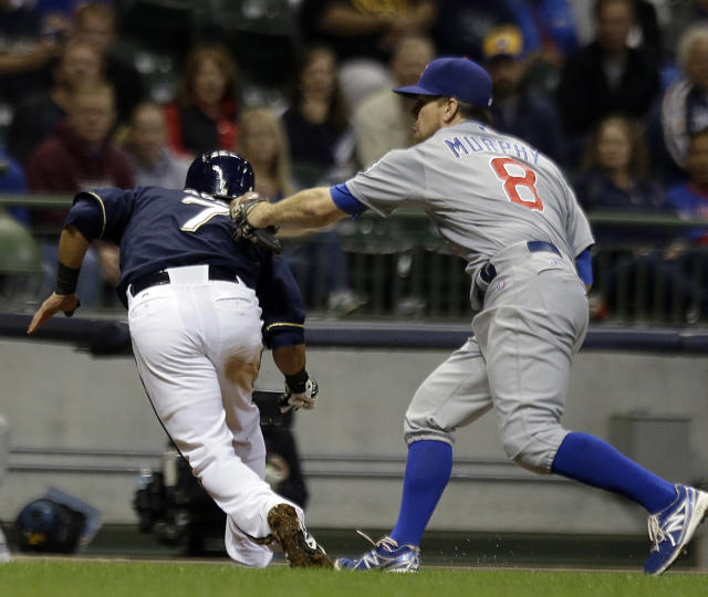 Chicago Cubs' Donnie Murphy (8) tags out Milwaukee Brewers' Norichika Aoki after Aoki was caught in a rundown during the sixth inning of a baseball game Tuesday, Sept. 17, 2013, in Milwaukee. (AP Photo/Morry Gash)