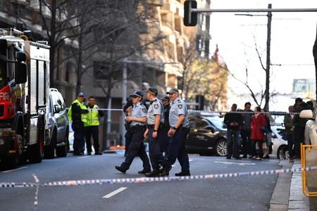 Police officers investigate a scene following reports of a stabbing in Sydney