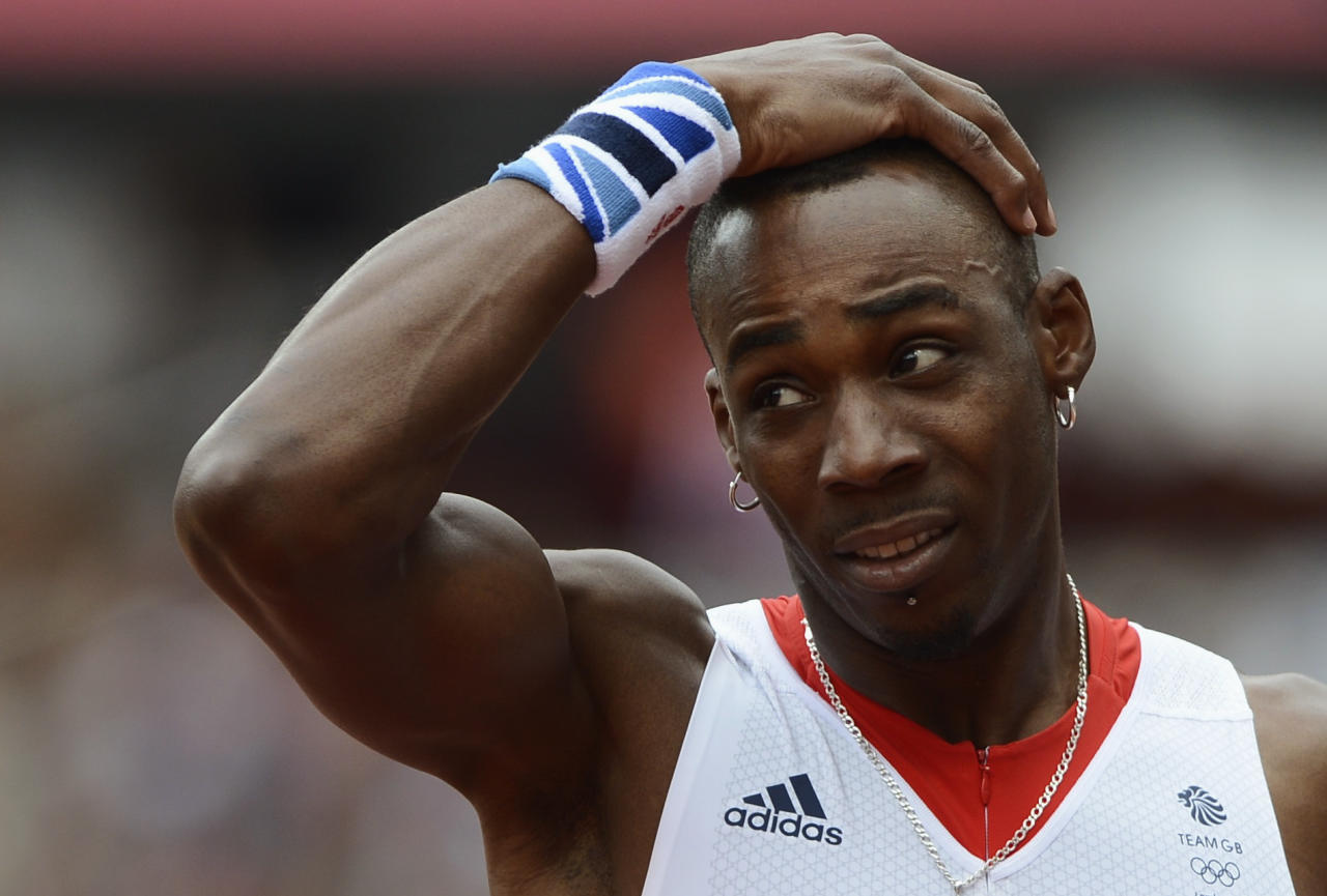 Britain's Phillips Idowu reacts after his jump in the men's triple jump qualification at the London 2012 Olympic Games at the Olympic Stadium August 7, 2012. REUTERS/Dylan Martinez (BRITAIN  - Tags: OLYMPICS SPORT ATHLETICS)