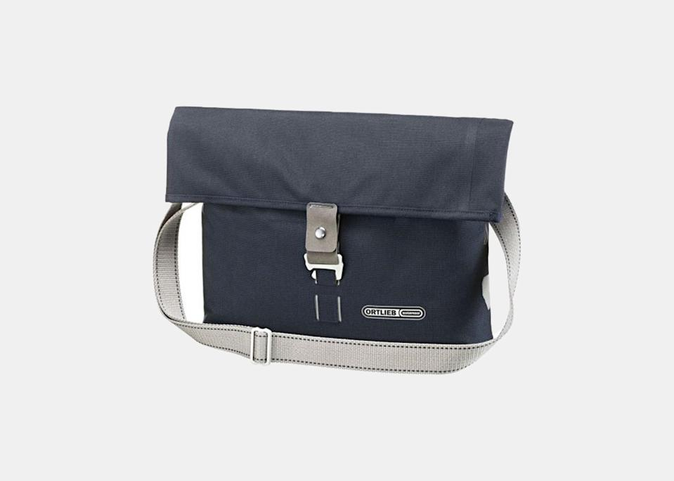 """Known for its design and innovation in bike accessories—waterproof zippers and sliding seal closures are among the patented design features—this German brand makes bags that are functional and durable, meeting any biking obstacles to help you ride faster and safer. Of their dozens of products, the <a href=""""https://cna.st/affiliate-link/a7yg5mSSUJJVzTx7msBrrSFsxc1JSbZQ7k2csacEEtZiZnZ9BPKEXnPUg83mpTPq1zPrASqLNSSMYq1moFPyCfmrFD6pD2vYL2ySiy5bNixsj?cid=6088358d211142d4f9886bd1"""" rel=""""nofollow noopener"""" target=""""_blank"""" data-ylk=""""slk:Twin-City Urban"""" class=""""link rapid-noclick-resp"""">Twin-City Urban</a> is among the best saddle bags: A two-in-one pannier and shoulder bag, Ortlieb's attachment system lets it hang easily and secure to your bike with very little hassle, before converting into a messenger-style bag with just one adjustment of the flap. Perfect for the urban commuter, it fits a full-sized laptop, has numerous pockets for smaller items, and comes with a five-year warranty. $207, Ortlieb. <a href=""""https://www.ortlieb.com/ch_de/twin-city-urban+F8102"""" rel=""""nofollow noopener"""" target=""""_blank"""" data-ylk=""""slk:Get it now!"""" class=""""link rapid-noclick-resp"""">Get it now!</a>"""