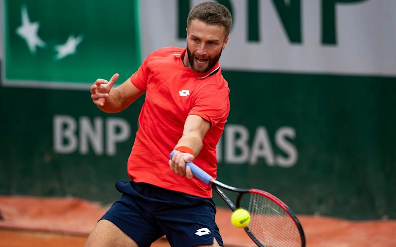 Liam Broady of Great Britain hits a forehand against Jiri Vesely - GETTY IMAGES