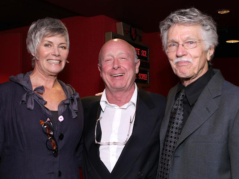 "LOS ANGELES, CA - MAY 17: Actress Kelly McGillis, director Tony Scott, and actor Tom Skerritt pose onstage before the screening of ""Top Gun"" during AFI & Walt Disney Pictures' ""A Cinematic Celebration of Jerry Bruckheimer"" held at the Mann Chinese 6 on May 17, 2010 in Los Angeles, California. (Photo by Alexandra Wyman/Getty Images for AFI)"